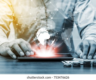 Technology people global network and online banking internet banking concept, Business man with laptop, cell phone, mobile phone and earth and world map virtual on business office table