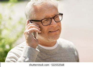 technology, people, lifestyle and communication concept - happy senior man calling on smartphone in city