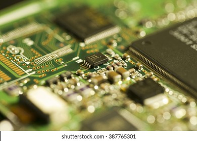Technology - printed circuit board, detail of very old piece of hardware, with shallow depth of field.