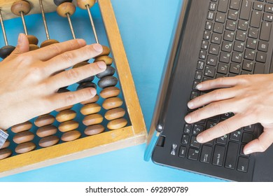 Technology progress concept, vintage abacus and new laptop on the blue background.