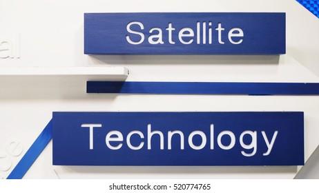 Technology & Satellite - word on blue background