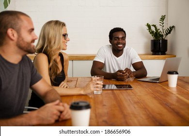 Technology startup entrepreneurs meeting at a boardroom table