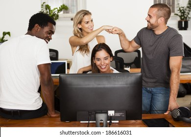 Technology startup team celebrates good news in their office