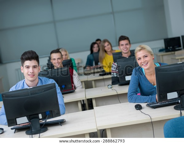technology students group in computer lab classroom