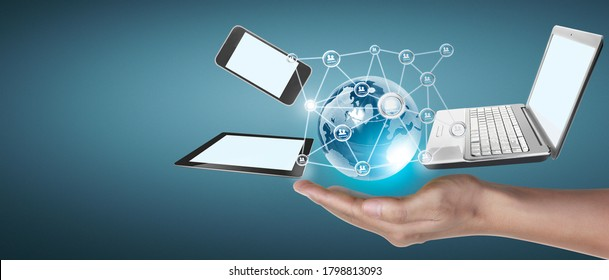Technology tech devices connected to each other in the hands