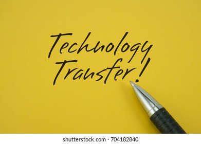 Technology Transfer! note with pen on yellow background