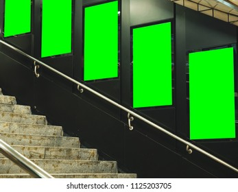 technology and travel in city concept from electronic billboard advertising in subway station and stairway background