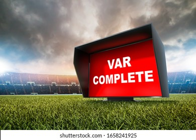 technology var decision complete.The video assistant referee scene a match official in football stadium.
