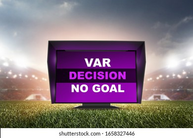 technology var decision no goal.The video assistant referee scene a match official in football stadium.
