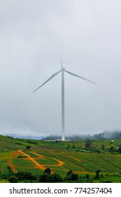 Tecnology on beautiful landscape nature of thailand.Scenery wind turbine field on the top mountain embrance over by fog in morning winter day with beautiful nature background.Landscape HDR grain Style