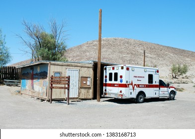 Tecopa Hot Springs California USA February Thirteenth, 2016. Southern Inyo County California Volunteer Fire District Firehouse With Ambulance Parked In Front.