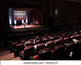 Ted talk international community with audience meeting business live in seminar hall blur for background. Ted talk show on stage of theatre concept.