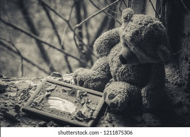 Teddy bear in an abandoned building. Destruction after the fighting.