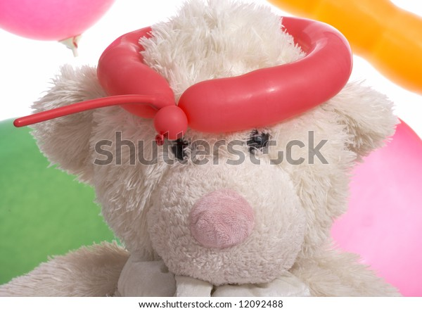 teddy bear with balloon on a white background