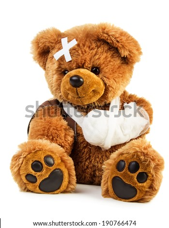 Teddy bear with bandage isolated on white background