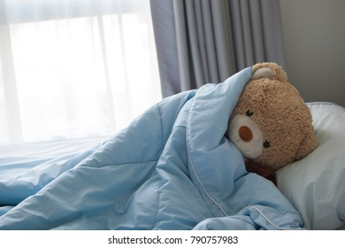 teddy bear in bed. Wake up in the morning.