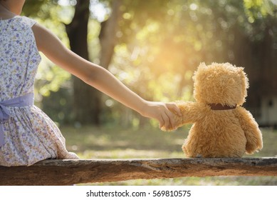 Teddy bear is a best friend for all little cute girl. Child autism can be more happy and fun when they're play in family. Feel love and care. Family Friendship Concept.