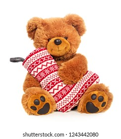 Teddy bear with Christmas stocking isolated on white background