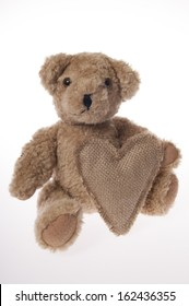 teddy bear with hessian Valentine heart isolated on white background