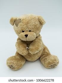 teddy bear holding engagement ring
