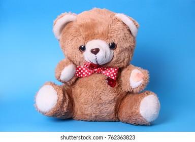 Teddy bear isolated on blue background