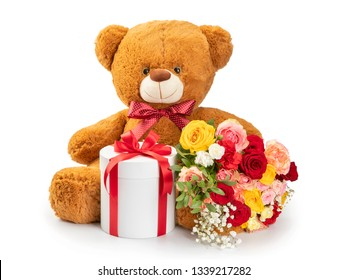 Teddy bear isolated on white background. Flowers and gift box