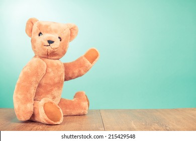 Teddy Bear old retro toy sitting front mint green gradient background