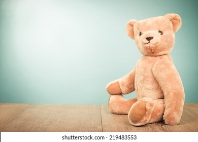 Teddy Bear old retro toy sitting front gradient background