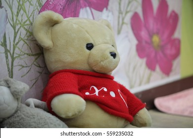 Teddy bear on the bed