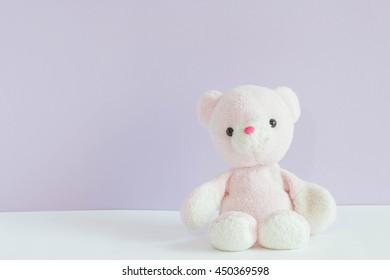 teddy bear on pastel background
