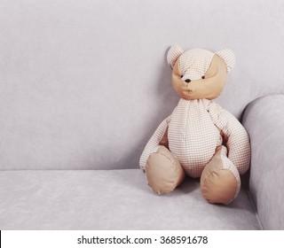 Teddy bear on a sofa, close up