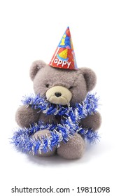 Teddy Bear with Party Hat and Tinsel on White Background