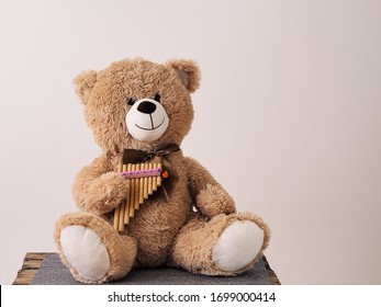 Teddy bear playing the Pan flute