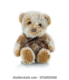 Teddy bear plushie doll isolated on white background with shadow reflection. Plush stuffed puppet on white backdrop. Light brown fluffy toy for children. Cute furry animal plaything.