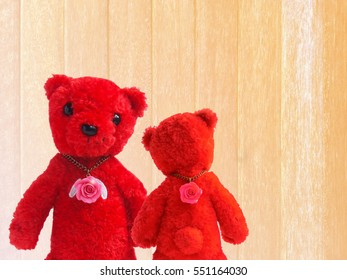 Teddy Bear red couple, and pink roses in white soft wood background. Valentines Day.