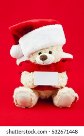 Teddy bear santa festive background with card for copy space