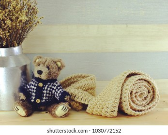 teddy bear with scarf and copy space background