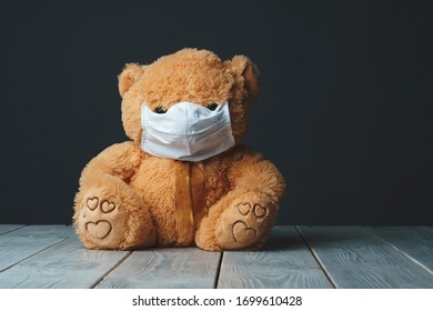 teddy bear sitting in medical mask beacuse of coronavirus