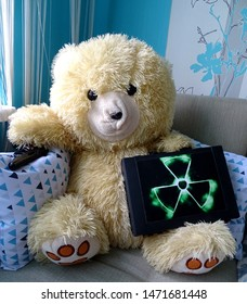 A teddy bear is sitting on the couch. Holding a nuclear case in one hand and a Makarov pistol in the other hand