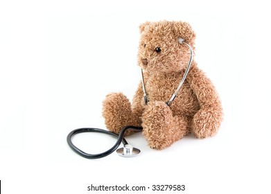 Teddy bear and stethoscope on a white background