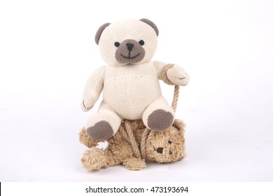 Teddy bear tied up with a rope, bullying