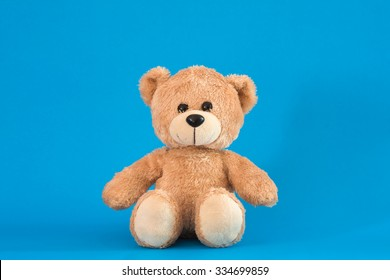 Teddy Bear toy alone with blue background