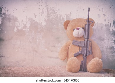 Teddy bear with toy gun vintage photo