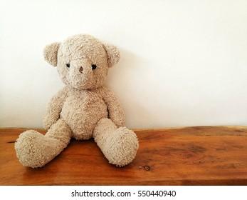teddy bear toy sitting alone on the wood chair