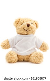 Teddy bear and white T-shirt on white background