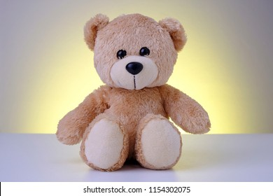 Teddy bear with yellow background