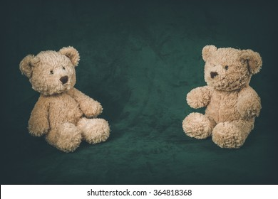 Teddy bears on a black background