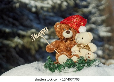 "Teddy Bears are sitting in a winter coniferous forest and holding a sign ""Happy"". Teddy holiday. Teddy bears and happy. Christmas Teddy. For a holiday gifts and letters. Winnie Pooh."