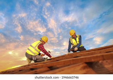 Teem of expertise construction male roofer carpenter wear safety uniform working on roofs structure on construction site