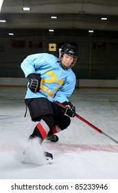 A Teen Age Hockey Player Makes Sharp Stop in the Rink